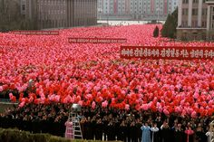 Thousands of residents applaud at a square during the inauguration of a mosaic portrait of Kim Jong-il in Pyongyang, April 9, 2012. North Korea has invited international journalists into the reclusive country to witness the launch of a weather observation satellite using a three-stage rocket in mid-April. The satellite launch is timed to celebrate the 100th anniversary of the birth of North Korean founder Kim Il Sung.     [Credit : Ed Flanagan / NBC News]