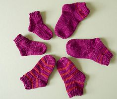 Toe Up socks for newborns to 1 year old. Can be done two at a time. Includes variations of heels and toes. By Sheila Toy Stromberg. Free