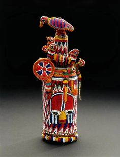 Africa | Beaded bottle from the Yoruba people of Nigeria | Glass bottle, glass beads, plant fiber, quill, thread, cotton cloth, string