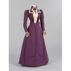 Wedding dress, ca 1899, worn on June 8, 1899. This crisply tailored purple silk dress was made and worn by Harriett Joyce for her marriage to Percy Raven Sams at St Andrew's Church, Earlsfield, Middlesex. Harriett worked as a lady's maid, while Percy worked for the London Water Board. Harriett chose to wear purple, as at 35, she considered herself too old for a traditional white gown. However, she trimmed her hat with wax orange-blossom, which was worn by brides for their first marriage.