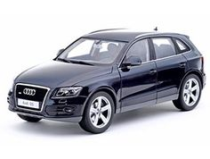 This Audi Q5 Diecast Model Car is Deep Sea Blue and features working wheels, steering and also opening bonnet with engine, doors, tailgate. It is made by Kyosho and is 1:18 scale (approx. 23cm / 9.1in long).  ...