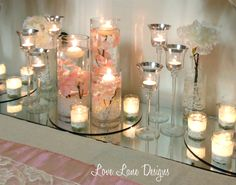 Pale pink orchids, floating candles and tealights - Wedding expo set up
