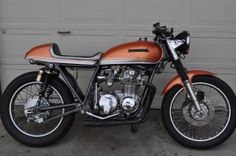 Orange CB 550 Cafe Racer with 5 Speed Transmission and Chrome Engine