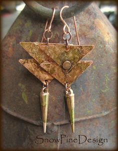Distressed Copper Triangulated Earrings by SnowPineDesign on Etsy Double Copper triangles have been distressed, stained, riveted and adorned with a stained metallic-clad spike. Super lightweight and intended to be a go-to pair. Hand crafted Copper ear wires, resin coated to protect the patina.