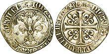 """Gros à la fleur de lis dit """"patte d'oie"""" sous Jean le Bon.-L'économie du royaume est alors très entamée par les agissements des Grandes Compagnies, composées de mercenaires démobilisées par la trêve, qui mettent le royaume en coupe réglée. Souvent Anglais ou Gascons, ils se réclament du roi d'Angleterre ou de Navarre, contribuant ainsi à ancrer un véritable sentiment d'anglophobie et à discréditer Charles le Mauvais."""