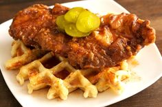 Twist on the classic Nashville hot chicken: fried boneless chicken breast, on top of a spicy jalapeño, bacon, and sharp cheddar waffle and fiery maple sauce