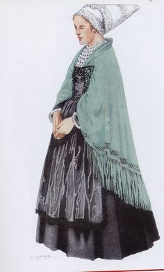 Costume du Trégor - la coiffe en forme de hennin est en tulle fin finement brodé. La jupe de cachemire - le tablier de soie dans lequel s'engage le grand châle de crêpe de soie àfranges