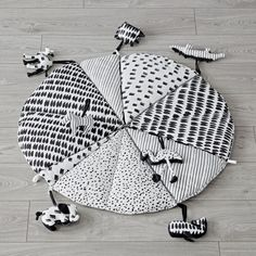 Shop Black and White Baby Play Mat with Rattles.  The high contrast design of this black and white baby play mat makes it ideal for newborns.  Plus, the seven coordinating animal rattles make it a tummy time or playtime must-have.