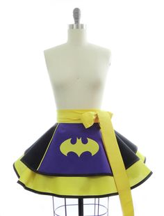 This stunning Purple Batty Girl apron plays with the new colors of BG.....purple, black, and yellow. It's a half apron with piping and a handdrawn, handpieced appliqued bat Creation time: 3-5 business