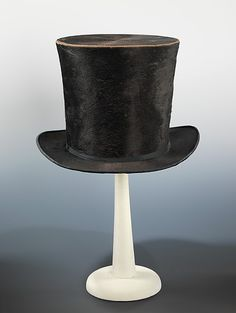 Top hat  Nash  (American)    Date:      ca. 1850  Culture:      American  Medium:      silk  Dimensions:      6 3/4 x 12 1/4 in. (17.1 x 31.1 cm)  Credit Line:      Brooklyn Museum Costume Collection at The Metropolitan Museum of Art, Gift of the Brooklyn Museum, 2009; Robert B. Woodward Memorial Fund, 1921  Accession Number:      2009.300.1659 MET