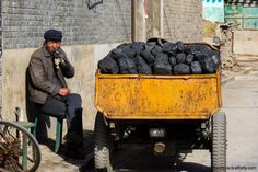 Coal seller has a quick ciggie  - #pingyao #china #travel
