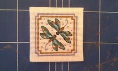A dragonfly cross stitch needle case I made as a present