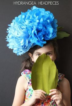 I might want to be a flower for halloween, and this would be impressive but easy to do! Tissue paper, a diy hat-like base with elastic to hold it on. Some hot glue and a bit of felt and POOF! Giant flower head thing! // hydrangea headpieces/tiffanie turner/corner blog/papelSF