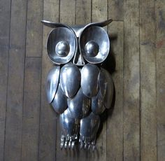 Owl made of Spoons Knives and forks Kitchen Utencils Welded together it hangs on the wall