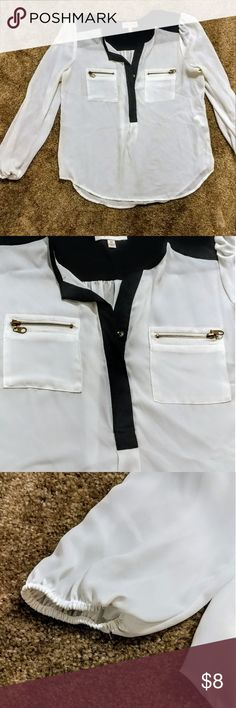 White and Black Blouse Sheer white and black long sleeve blouse with gold zippers on the pockets. Sleeves have elastic at the wrist opening. Super cute for business casual! My Michelle Tops Blouses