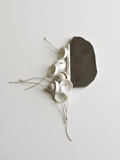 Chequita Nahar - Switi Watra - brooch, 2010, snakewood, porcelain, pine, silver, cord - 110 x 140 x 280 mm