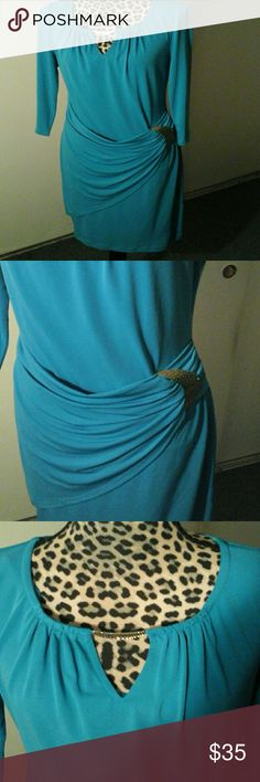 Dress Fitted, flirty  and sexy.  Hits just above the knee, front wrap with gold metal  accents at the  chest  and the waist .  Dress is 95 % polyester  and 5% spandex worn  once . Thalia   Dresses Midi