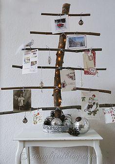 homemade Christmas tree branches display Christmas cards via Song Bird