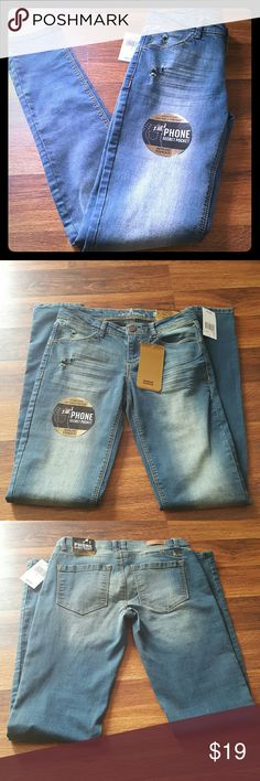 ALMOST FAMOUS SKINNY JEANS New never used Almost famous jeans with cell phone pockets. Nice fit form fitting. Made of stretch denim w/slits on the knees. Almost Famous Pants Skinny