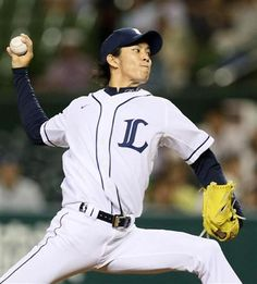 Takayuki Kishi #11 hurls 7 innings of 1-run ball with striking out 3 Fighters while scattering 1 hit as he notches his 10th win of the 2013 season at Seibu Dome on September 17, 2013 in Tokorozawa, Saitama.