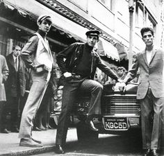 British fashion icon John Stephen (far right), secure in his status as king of Carnaby Street and Mod fashion, From the book 'The Sixties: A Pictorial Review' by Chris Pearce