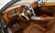 Fornasari's Gigi 311 Sports Car Hand finished interior, with aluminum and leather accents is frequented with old world wood