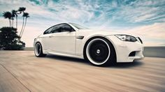 BMW M3 – white paint, black rims + beach + awesome sky = fantastic photo