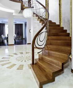 />Curved zigzag stair made of stained oak. Balustrade of hand-wrought steel with wooden handrails. Private residential project, designed by TRĄBCZYŃSKI. Interior Stair Railing, Stair Railing Design, Home Stairs Design, House Design, Double Story House, Beautiful Stairs, Fancy Houses, Wooden Stairs, House Stairs