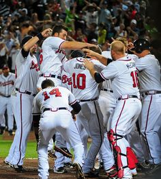 #10 Chipper Jones congratulated by his teammates after he hit the walk off home run
