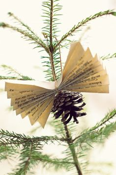DIY Pinecone & Book Page Christmas Decorations Christmas Lights Garland, Christmas Ornaments To Make, Christmas Crafts, Merry Christmas, Christmas Decorations, Holiday Decor, Hygge, Poinsettia, Pine Cones