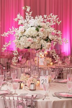These original wedding reception ideas are sure to leave you inspired. From non-floral arrangements to striking grand blooms, we've found options to suit every wedding style and budget! Unique Centerpieces, Wedding Table Centerpieces, Flower Centerpieces, Ceremony Decorations, Tall Centerpiece, Centerpiece Ideas, Mod Wedding, Floral Wedding, Wedding Reception