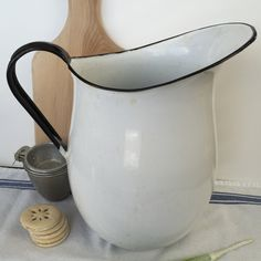 Well , these white enamel pitchers are getting tough to find. They are especially hard to find in good condition. This one is not perfect ( well