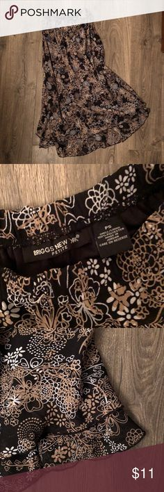 "Petite Skirt Lovely black skirt with camel & white flower designs.  Double ruffle at bottoms, flows beautifully.  Elastic waist,  approx 34"" long. briggs new york Skirts"