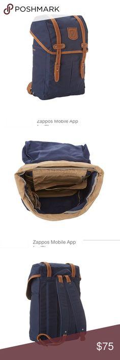 Fjallraven Rucksack Backpack. Navy Rucksack No.21 Small.                 Adjustable shoulder straps with dual side pockets for added storage.  Have concealer mark inside the flap. Fjallraven Bags Backpacks
