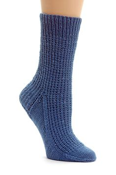 "Strie means ""stripe,"" ""groove,"" or ""gore"" in French, so it seems like the perfect name for these very simple, garter-stitch-ribbed socks with French heels and wedge toes. This version is worked from the top down."