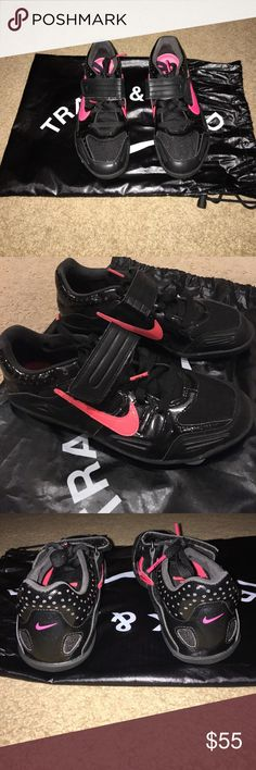 Nike Throwing Shoes Lightly used. Haven't been worn in over 3 years. The sole of the shoe is not worn out (just some light dirt marks). Comes with Nike Track & Field bag to store shoes. Mens size 5 which equals to a 6.5 in womens. Always open to negotiation!! Nike Shoes Athletic Shoes