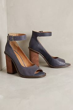 Kelsi Dagger consistently breaks down fashion boundaries with unexpected details that appeal to both classic and trendy sensibilities to the uptown and downtown girl alike. These leather pumps strike a balance between sultry and sophisticated with a chunky heel ankle strap and peeptoe. #Fashion #Shoes
