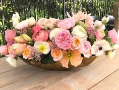 Pink, peach, and white centerpiece by Carolas Floral