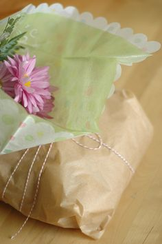 fresh bread + parchment paper + flowers (gifts)