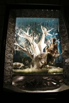 New York Holiday Windows Go High Tech - Frozen and enchanted fashion and living creatures in a Bergdorf Goodman window.