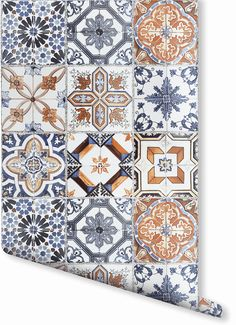 Add some ornate Moroccan style to your home. This toned blue and orange faux tile wallpaper allows you to give your walls a vintage tiled look. This design would be perfect in any kitchen for a rustic, homey look.