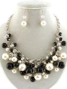 black and white pearls.. would match the bracelet, ring, and earrings from Mrs. Givens