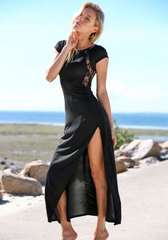 Black Sheer Lace Maxi - Dress.orgeous maxi dress featuring sheer floral lace detailing and long slit at side. Soft, lightweight fabric. Zip closure at back, unlined.