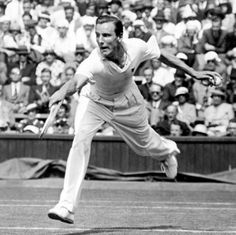 Fred Perry lunges to play a backhand during the Wimbledon men's singles final in 1934. Photo: PA