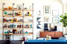 DYI plumbing pipe shelving - Home Tour: An Architect's Modern Bachelorette Pad via @mydomaine