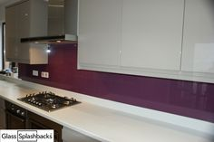Plum Glass Splashback with mink units. Add personality by choosing any colour shade in the world! We can use any branded paint from Sanderson-Designers Guild to achieve the look you want. Visit http://www.diysplashbacks.co.uk/glass-splashbacks/diyquote.aspx to discover more.