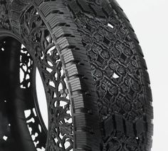 """For his series titled """"Pneu"""", Belgian artist Wim Delvoye created a series of decorative objects by hand-carving intricate patterns and floral motifs on used car tires. Through his manipulation of found objects, Delvoye transforms things that seem useful in everyday life into sculptural pieces that carry a different value from their original intended purpose. Delvoye calls his own approach to art 'glocal', referring to 'local' and 'global', which is his own ironical way of describing art."""