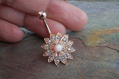 Opal belly button rings opal flower rose gold belly button jewelry ring with a band of crystals that surround the center white opal. Will arrive in