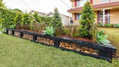 Gabion retaining wall on pinterest sleeper steps gabion Yahoo better homes and gardens