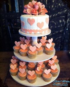 Wedding cake, not the design just style with cupcakes & topper